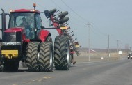 Two men on tractors pulling pickup from ditch charged with impaired driving