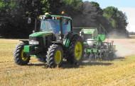 Autonomous tractor planting soybeans in Iowa