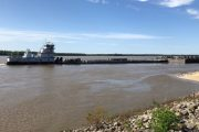 Disrupted grain shipments resume on Mississippi, beneath cracked bridge